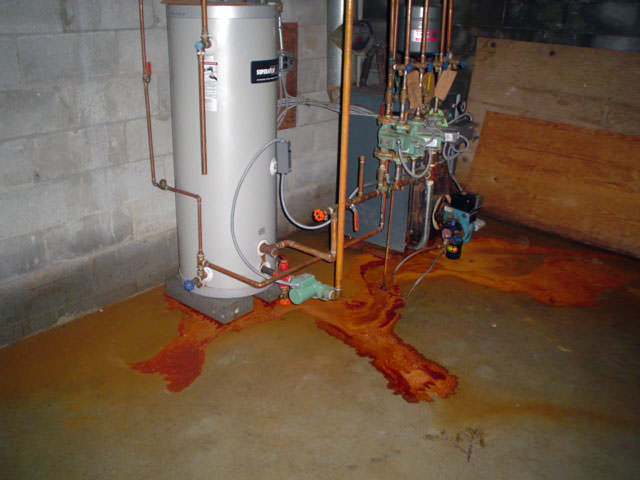 iron ochre water on a concrete basement floor staining everything