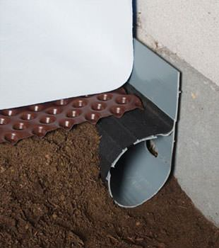Closeup of a crawl space drainage system installed in Regina