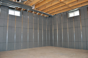 Insulating and finishing basement walls