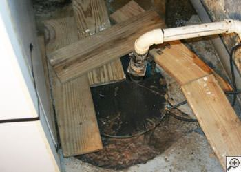 An ugly, clogged sump pump system in Melville, Saskatchewan and Manitoba