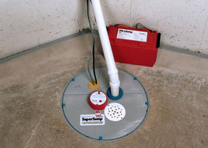 A sump pump system with a battery backup system installed in Carlyle