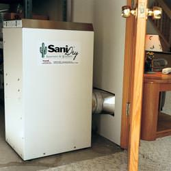 A basement dehumidifier with an ENERGY STAR® rating ducting dry air into a finished area of the basement  in Melita