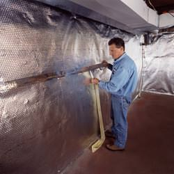 Installation of a radiant heat and vapor barrier on a basement wall in Rivers