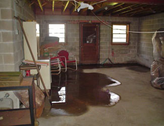 a flooded basement floor in a Melita home