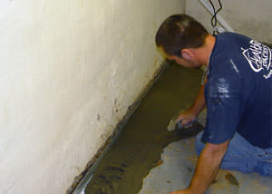 Restoring a concrete slab floor with fresh concrete after jackhammering it and installing a drain system in Langenburg.