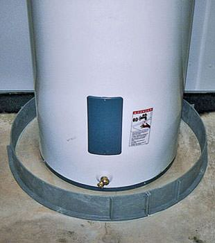 An old water heater in Oxbow, SK and MB with flood protection installed